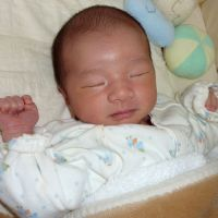 Entering the world: A newborn lies on a bed in Tokyo. | KYODO