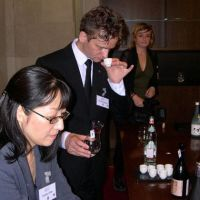 Taste-testers: Kumiko Ota and Xavier Chapelou of the Sake Sommelier Association sample a selection of blends at Harrods department store in London on Aug. 20. | KYODO