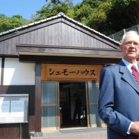 Legacy: Wilfred Schmoe, son of peace activist Floyd Schmoe, stands Wednesday in front of one of the houses in Hiroshima his father built for survivors of the 1945 atomic bombing. | KYODO