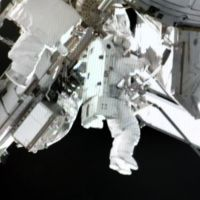 Record time: Astronaut Akihiko Hoshide conducts his third spacewalk early Friday in the course of doing repair work at the International Space Station. | NASA TV/KYODO