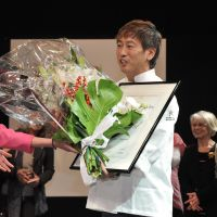 Sweet victory: Susumu Koyama receives flowers upon being named top foreign chocolatier by France's Le Club des Croqueurs de Chocolat at a ceremony in Paris on Friday. | KYODO