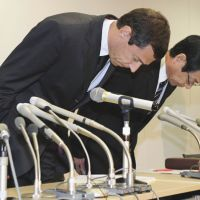 Condolences: Top executives of Schindler Elevator K.K. bow during a news conference in Tokyo on Oct. 31 after an employee of a Kanazawa, Ishikawa Prefecture, hotel was killed last week in an accident involving one of the firm's elevators. | KYODO