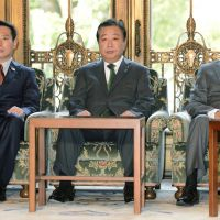 Not sitting pretty: Prime Minister Yoshihiko Noda is flanked by Deputy Prime Minister Katsuya Okada (right) and national policy minister Seiji Maehara before a Friday Cabinet meeting. | KYODO