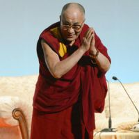 The Dalai Lama greets attendees to a speaking engagement Sunday in Naha, Okinawa. | KYODO