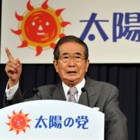 Still at it: Former Tokyo Gov. Shintaro Ishihara gestures to reporters Tuesday as he announces the launch of his new political party, Taiyo no To (The Sunrise Party). | YOSHIAKI MIURA