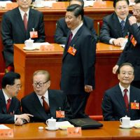 Helm change: Chinese Vice President Xi Jinping (center) passes behind President Hu Jintao (front left), former President Jiang Zemin (front center) and Premier Wen Jiabao (front right) on the opening day of the 18th Communist Party Congress at the Great Hall of the People in Beijing on Thursday. | KYODO