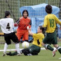 On the ball: Women soccer players in their 60s (two in center) try to block a shot by their opponents during a match in Kagoshima in September. They belong to Team Higashitaniyama Ogojo. Five of the team's 11 players are in their 60s. | KYODO