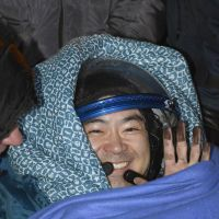 Terra firma: Astronaut Akihiko Hoshide smiles Monday upon his return to Earth after a four-month mission to the International Space Station. The Russian Soyuz spacecraft carrying Hoshide as well as an American and a Russian parachuted safely onto a plain in Kazakhstan at 7:56 a.m. local time. | KYODO