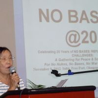 A lesson to learn: Toshiko Nagado, 62, a retired teacher from Okinawa, speaks at a gathering Nov. 8 at the former U.S. naval base in Subic Bay, Philippines, to mark the 20th anniversary of the total closure of U.S. bases in the country. | KYODO