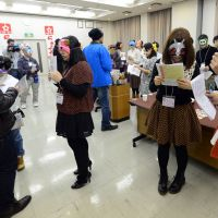 Mix, match: Participants at an 'otaku' matchmaking party mingle Friday in Washinomiya, Saitama Prefecture. | AFP-JIJI