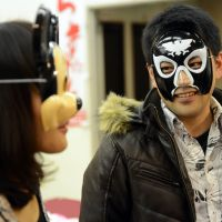 Face-off: A man posing as renowned 16th-century tea ceremony master Furuta Oribe introduces himself to a woman wearing a Mickey Mouse mask at a matchmaking party for self-confessed 'otaku' in Washinomiya, Saitama Prefecture, on Friday. | AFP-JIJI