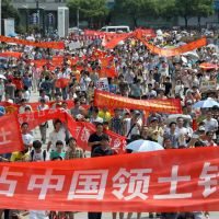 Boiling point: Citizens demand that Beijing exert its claim over the Senkaku Islands during an anti-Japan demonstration in Hangzhou, China, on Aug. 19. | KYODO