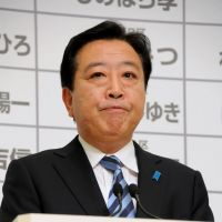 Prime Minister Yoshihiko Noda announces his resignation at a news conference Sunday. | SATOKO KAWASAKI