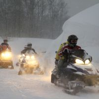 To the rescue: The Akita Prefectural Police mountain rescue squad sets out on snowmobiles Friday morning to rescue eight people who were stranded  Wednesday on Mount Chokai. | KYODO