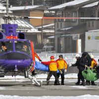 Chopper rescue: A climber who became stranded on Mount Nishihotaka in Gifu Prefecture and had to be airlifted by a police rescue team arrives in Takayama, also in Gifu, on Saturday. | KYODO