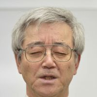 Eyes wide shut: Yoshihiro Sato, principal of Sakuranomiya Senior High School, attends a news conference Wednesday evening. | KYODO