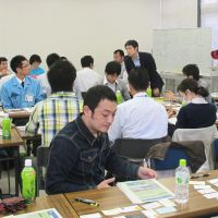 Change from the inside: Members of Project K and officials at the Rikuzentakata city office in Iwate Prefecture exchange opinions on administrative reform in May.   KYODO