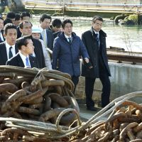 Leading the way: Prime Minister Shinzo Abe visits a shipbuilder in Ishinomaki, Miyagi Prefecture, during a trip aimed at showing his commitment to disaster-hit areas in Tohoku on Saturday. | KYODO