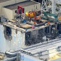 Costly cleanup: Work to remove radioactive debris from the building for reactor 4 proceeds last July at the Fukushima No. 1 power plant in Fukushima Prefecture. | KYODO