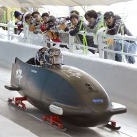 Bob in the track: Developers of the nation's first bobsled watch a December test run in the city of Nagano. | KYODO