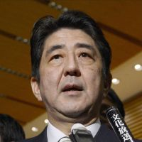 Abe strikes control pose as Japan scrambles for information