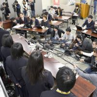 Opposing team: Students at Sakuranomiya Senior High School in the city of Osaka meet the press Monday evening to lodge a protest over the board of education's decision to no longer offer special slots for sports majors.   KYODO