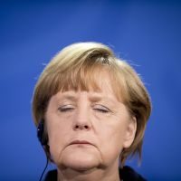 Merkel worried by Tokyo's actions to lower yen