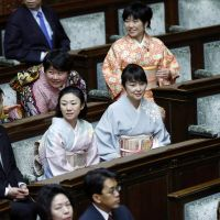 Traditional touch: Lawmakers participate in the opening ceremony for the Diet on Monday in the Upper House. About 80 members of a nonpartisan parliamentary group promoting the use of kimono attended the first session. | AP