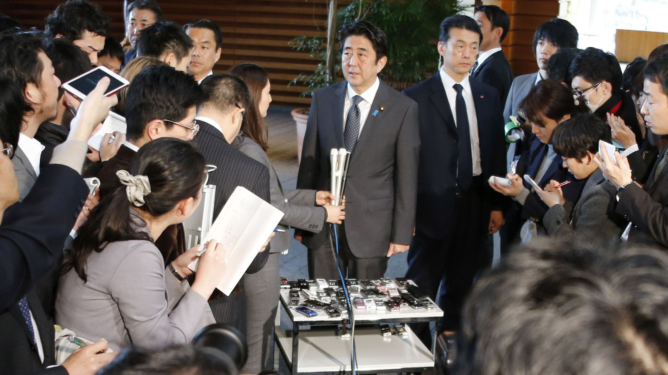 Playing it safe: Prime Minister Shinzo Abe speaks at the prime minister's office on Jan. 22. | AP