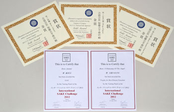 Some of the awards that the brewery has received. Below: A kagami-biraki sake barrel opening event is held at the opening function of the Artistic Gymnastics World Championships in Tokyo in 2011.