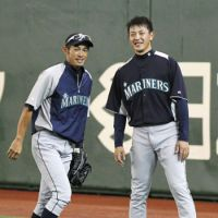 Day at the park: Seattle Mariners outfielder Ichiro Suzuki (left) and pitcher Hisashi Iwakuma are back in Japan for Major League Baseball's season-opening series against the Oakland A's. The teams held workouts on Saturday at Tokyo Dome. | KYODO