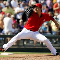 Two scoreless frames: Los Angeles' Hisanori Takahashi pitches against Colorado in the seventh inning at spring training on Monday. The Rockies beat the Angels 6-2.   AP