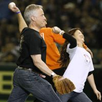 Starting anew: Andy Anderson (front), whose daughter Taylor died in the March 11 tsunami last year in Miyagi Prefecture, throws out a ceremonial first pitch at Tokyo Dome on Thursday before the Seattle Mariners-Oakland Athletics game. Anderson and his wife, Jean, are involved in helping Tohoku rebuild with the establishment of the Taylor Anderson Memorial Fund. | KYODO