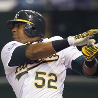 Power display: Athletics outfielder Yoenis Cespedes smacks a two-run home run in the seventh inning off Mariners reliever Shawn Kelley on Thursday at Tokyo Dome. Oakland beat Seattle 4-1. | AP