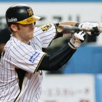 No pain, no gain: Hanshin Tigers outfielder Matt Murton missed the first three games of the season with a strained hamstring. | KYODO