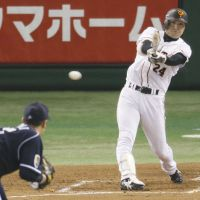 Early momentum: The Giants' Yoshinobu Takahashi strokes a two-run single in the first inning off Dragons starter Yudai Kawai at Tokyo Dome on Tuesday. The game ended in a 6-6 tie. | KYODO