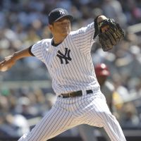 Smashing debut: New York's Hiroki Kuroda throws a pitch during the first inning against Los Angeles on Friday. The Yankees blanked the Angels 5-0. | AP