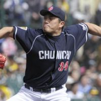 Golden oldie: Masahiro Yamamoto pitches during the Dragons' 3-0 win over the Tigers on Sunday. | KYODO