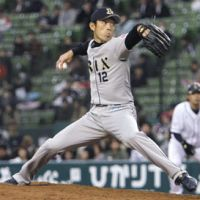 Job well done: Hiroshi Kisanuki pitches during the Buffaloes' 6-2 victory over the Lions on Sunday at Seibu Dome. | KYODO
