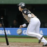 Just enough: Shinya Tsuruoka drives in the only run of the game with a sacrifice fly in the eighth inning of the Fighters' 1-0 win over the Buffaloes on Sunday in Kobe. | KYODO
