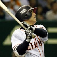 Big hit: The Giants' Yoshinobu Takahashi smacks a two-run home run in the third inning against the Carp on Thursday at Tokyo Dome. Yomiuri defeated Hiroshima 4-3. | KYODO