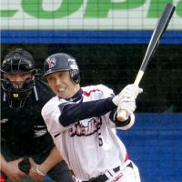 Welcome to the party: Shinya Miyamoto hits a single to become the 40th NPB player to record 2,000 career hits on Friday at Jingu Stadium.   KYODO