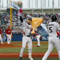 Let it sink in: Swallows infielder Shinya Miyamoto celebrates after his 2,000th career hit during Yakult's 8-4 win over Hiroshima on Friday.   KYODO