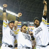 Kenta Nakanishi, Nobuhiro Matsuda and Wily Mo Pena of the Softank Hawks, who each scored a home run Sunday, celebrate their team's trouncing of the Rakuten Eagles. | KYODO PHOTO