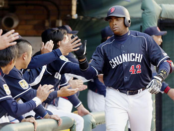 Welcome home: Chunichi's Tony Blanco accepts his teammates' congratulations after hitting a two-run home run in the Dragons' 3-0 win over the Eagles on Thursday. | KYODO
