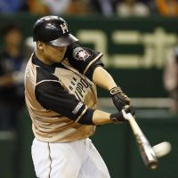 Sho thing: Hokkaido Nippon Ham's Sho Nakata hits a tiebreaking two-run homer in the seventh inning of the Fighters' 3-2 win over the Giants at Tokyo Dome on Monday. | KYODO