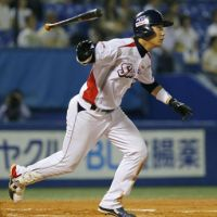 Triple trouble: Tokyo Yakult's Shingo Kawabata hits a three-run homer during the sixth inning of the Swallows' 12-3 win over the Dragons on Thursday. | KYODO