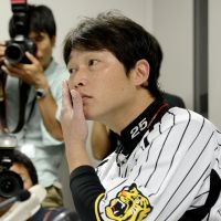 All ears: Takahiro Arai listens to a question during a news conference Tuesday. | KYODO