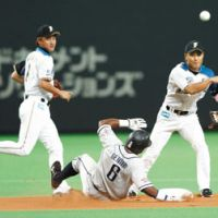 Uncertain status: Fighters second baseman Kensuke Tanaka (right) is out for the season because of an elbow injury sustained in a collision with Hiroyuki Nakajima. | KYODO