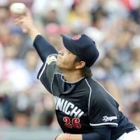 Double figures: Chunichi's Soma Yamauchi pitches en route to his 10th win of the season during the Dragons' 2-0 win over the Carp on Sunday. | KYODO